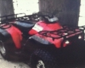 Red Honda farm quad